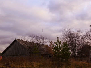 Clouds sweep over the barn. Time Lapse. 320x240 Footage