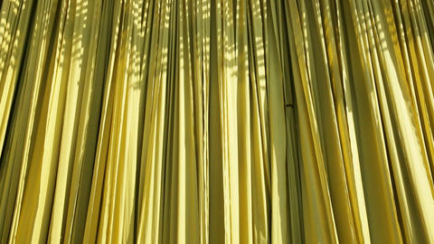 Newly dyed fabric hanging from Bamboo poles to dry Live Action