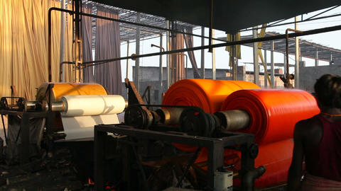 Newly dyed fabric being washed and rolled, Sari ga Live Action