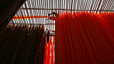 Newly dyed fabric hanging from Bamboo poles to dry Footage