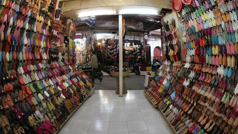 Soft leather Moroccan slippers in the Souk, Medina Live Action