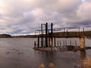 Dam on the background of clouds. Time Lapse. 320x2 Footage
