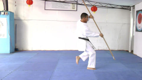 Man in karate practicing with a bo in his hands Footage