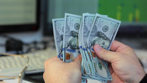 Hands Counting Dollars stock footage