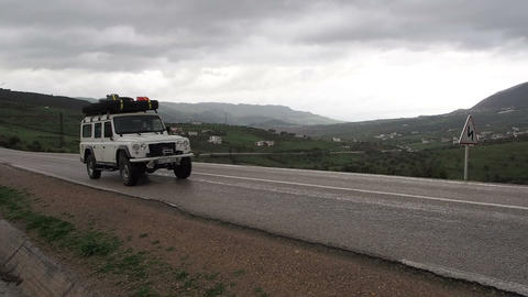 SUV Passes on Highway Near El Hoceima Morocco - FT Footage