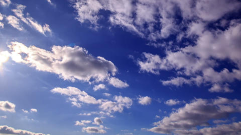 White clouds on a blue background. Time Lapse. 128 Footage