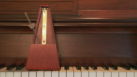 Metronome And Piano stock footage