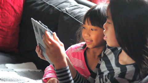 Asian Girls Enjoy Sharing Time On Digital Tablet Footage