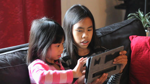 Cute Asian Girls Playing Games On Tablet Together Footage