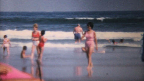 Woman In Pink Bathing Suit At The Beach 1967 stock footage