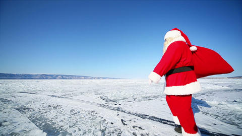 Santa With Gifts Goes Into the Distance Footage