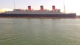 POV Tour Boat Passing Queen Mary Ship In Harbor stock footage