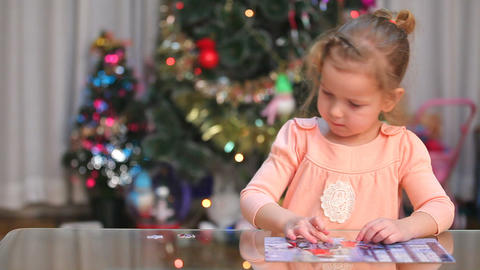 Little Child Solving A Puzzle stock footage