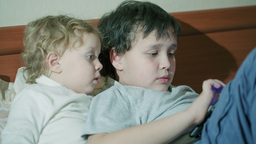 Two Young Children Playing With A Tablet stock footage