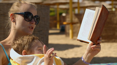 Reading stories on the beach Footage
