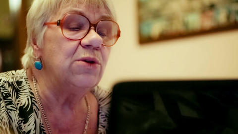 Senior Woman Having A Video Chat stock footage