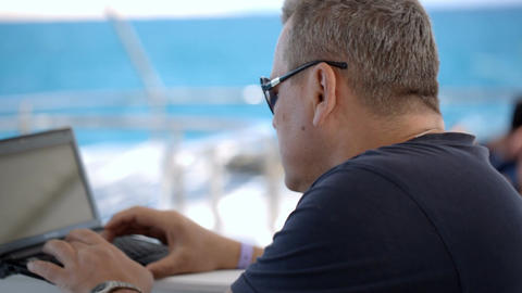 Using laptop during sea traveling Live Action
