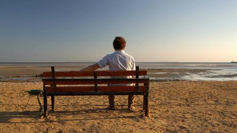 Man sitting alone on the beach Footage