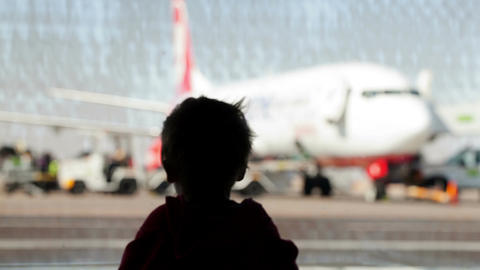 Little boy watching planes at the airport Footage