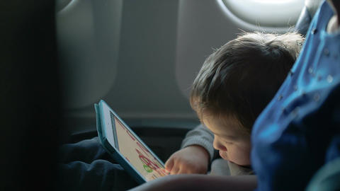 Little Boy Traveling In An Airplane stock footage