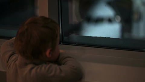 Boy looking at the plane Footage