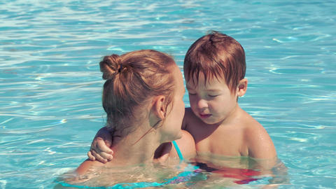 Mother and her son in the outdoor swimming pool Footage