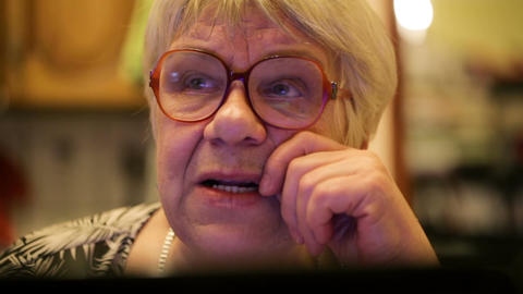 Modern elderly woman using skype Footage
