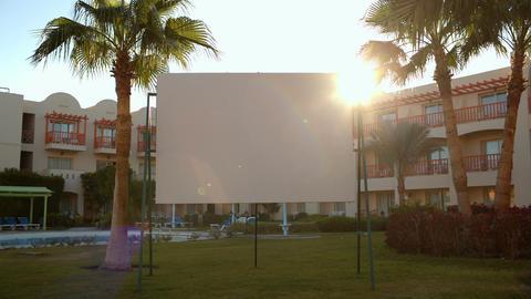 Sun flare behind a blank urban billboard Footage