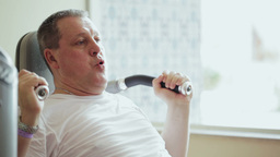 Working Out On Exercise Machine stock footage