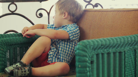 Boy sitting in the armchair Footage