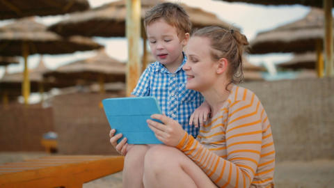 Little Boy With Is Mother At A Beach Resort stock footage