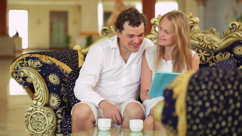 Couple With Touchpad On The Sofa In The Hotel stock footage