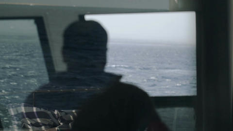 Back View Of Captain Driving A Yacht stock footage