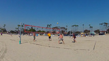 Young Men Playing Volleyball At Beach Wide Angle stock footage