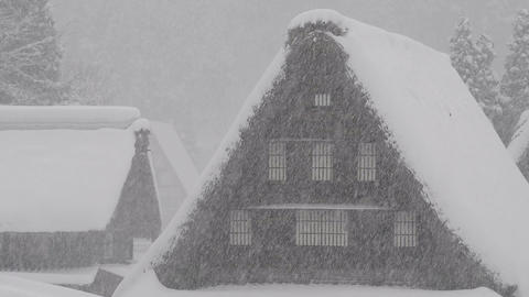 Snow falling on the winter house,in Toyama,Japan Footage