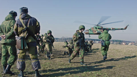 Soldiers. Helicopter Taking Off On A Background stock footage