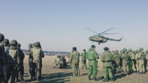 Soldiers Are Waiting When Helicopter Will Land stock footage