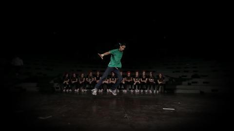 Hip-hop dancer dances in photo studio with black b Footage