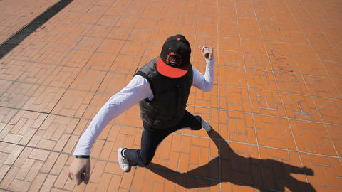Hip-hop Dancer In Cap Dances In The Street Of Sara stock footage