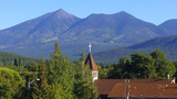 Church Steeple With Mountains Behind Flagstaff AZ stock footage