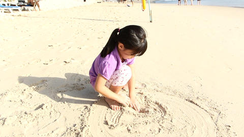 Cute Girl Playing Sand On The Beach stock footage