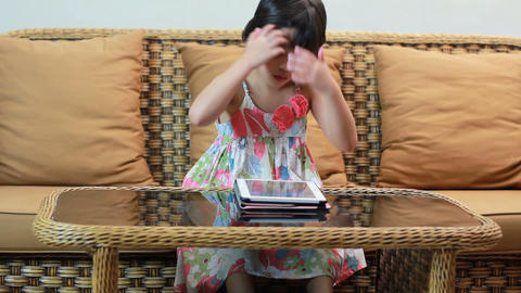 Little Asian Girl Playing Tablet stock footage