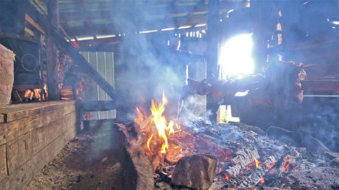 Traditional Chilean BBQ cooking lamb at Termas Por Live Action
