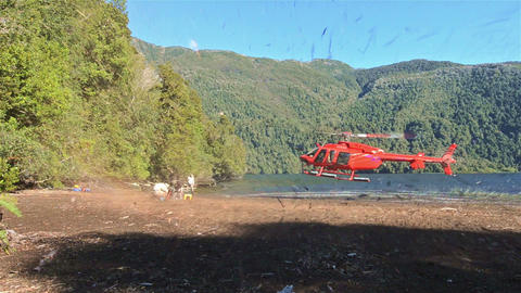 Helicopter landing on a beach at Ceasar Lake in Pa Footage