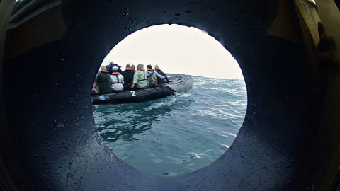 View through a ship's porthole of guests departing Footage