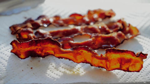 Cooked bacon in the morning light Footage