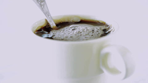 Milk or cream is poured into coffee Footage