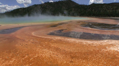 Steam rises from a geothermal lake at the Grand Pr Footage