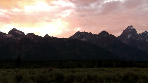 Slow pan across the Grand Tetons mountains at dusk Footage