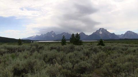 Slow pan across the Grand Tetons mountain range Footage
